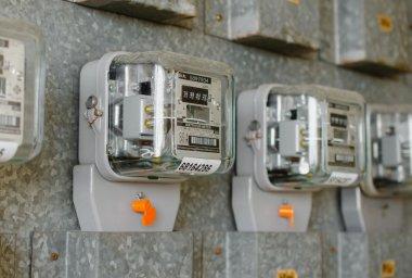 Watt hour Electric meter measurement tool at apartment