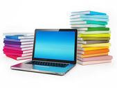 Fényképek laptop és tőzsdei könyvek