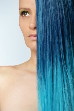 Young beautiful woman with blue hair