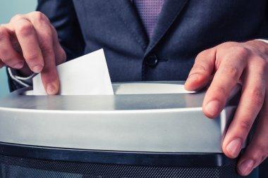 Businessman shredding documents