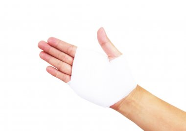 Bandaged hand isolated on white, with clipping path
