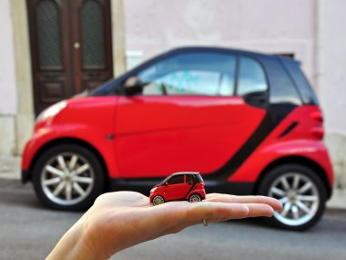 Red smart car: small the smaller