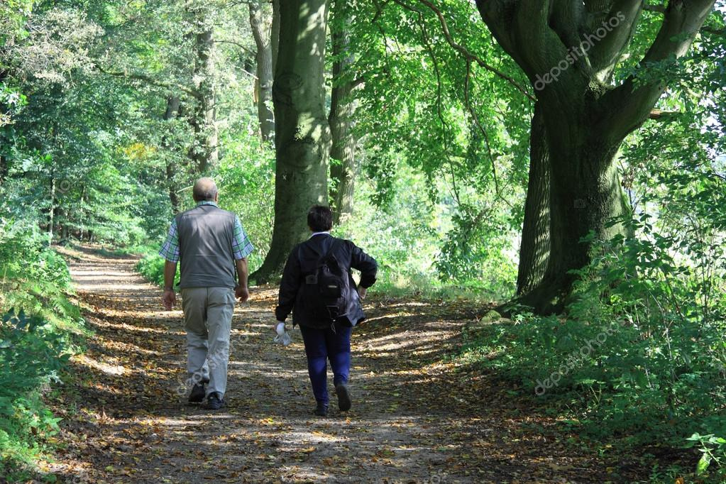 Older couple together walk in the bunch