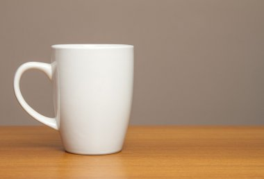 White mug on wooden table