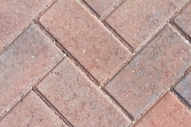 Close up image of red block pavior driveway