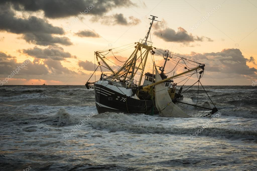 beached fishing boat at a Dutch beach