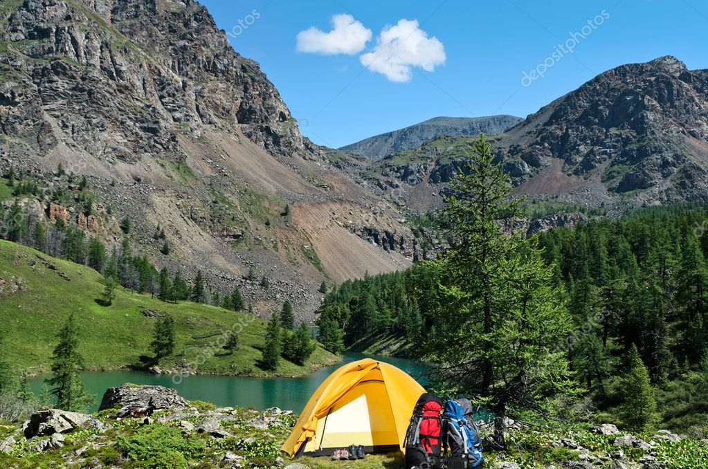 The camping tent near a mountain lake