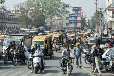 Traffic of people, cars and motorbikes in the street of New Delhi, India. one morning during my travel in india. a lot of people moving walking in the street everywhere.