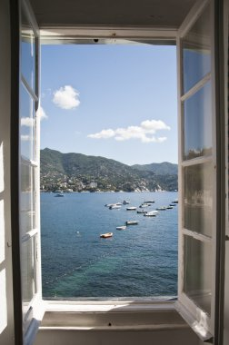 A wonderful view from the opened window to the sea