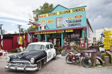 Classic Car Scene - Seligman, Route 66, Arizona. Famous as the origin of historic Route 66 and inspiration for the town of Radiator Springs in the Pixar movie Cars.