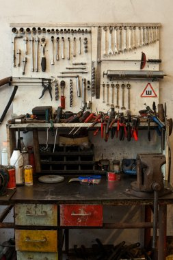 many dirty tools on table and dashboard