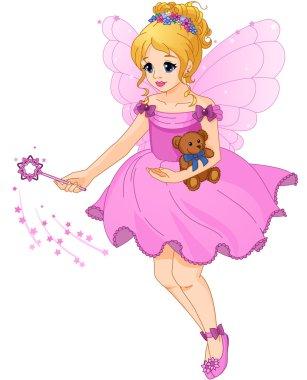 Cute girl in a purple dress with fairy wings.