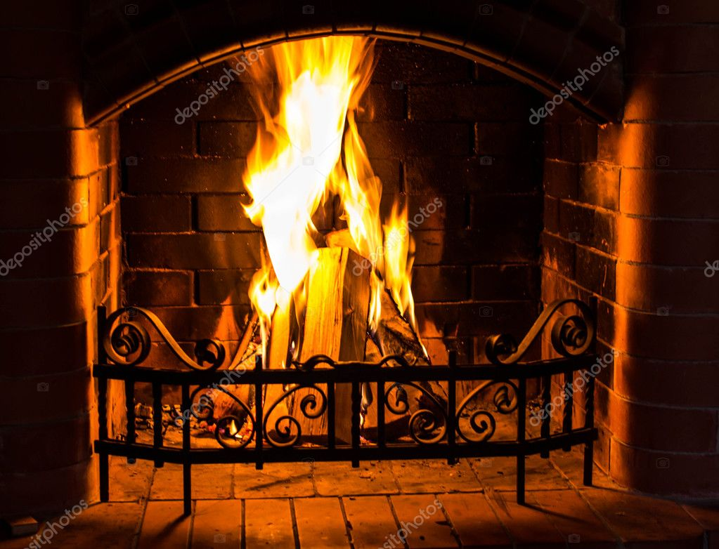 Home Fire burning in the fireplace. Seasonal and holiday fire.