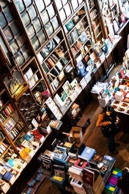PORTO, PORTUGAL - APRIL, 4: Customers shop for books in old european bookstore Livraria Lello on April 4, 2011 in Porto, Portugal