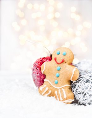 Gingerbread Man cookie, festive decorations and Christmas lights