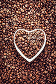 Photo Roasted Coffee Beans in a Heart shaped bowl