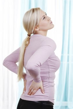 Woman with strong back pain
