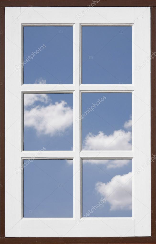 Mirror window reflecting blue sky
