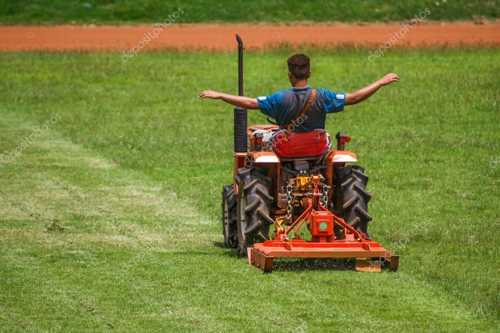 man on mower cutting grass