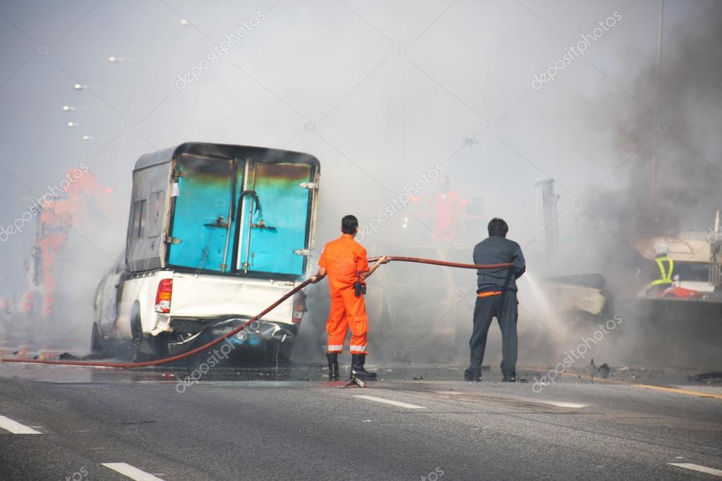 Firefighters fire car crash — Stock Photo © chartcameraman #41106773