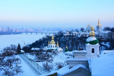 Kiev-Pechersk monastery and frozen river Dnipro