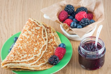 Delicious pancakes with jam and fruit
