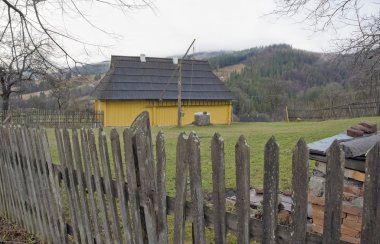 Yellow house in the country.