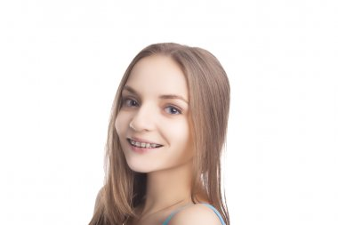 Portrait of Young Caucasian Girl Wearing Teeth Brackets