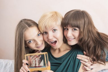 Three Young Caucasian Girls With Teeth Brackets Sitting Together