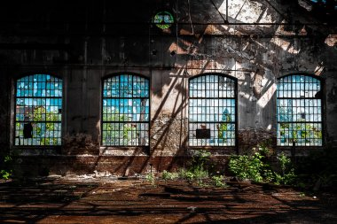Photo of an Abandoned industrial interior with bright light