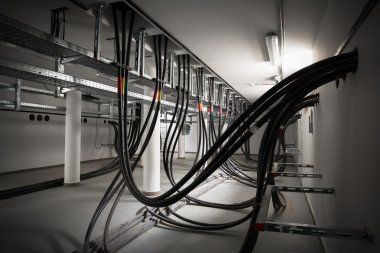 cellar of an electric station, incoming electric wires
