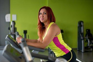 Beautiful woman exercising on an exercise bike