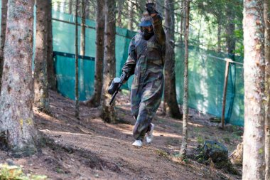 Paintball player walking away