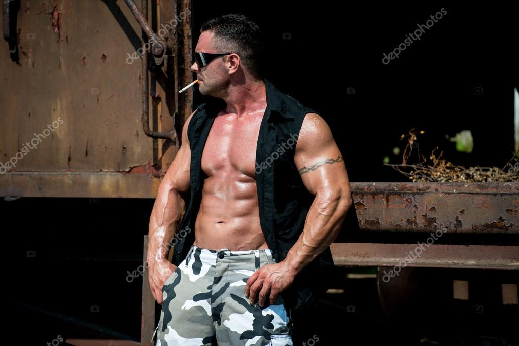 Bodybuilder Smoking A Cigar