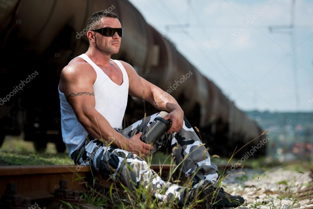 Man Resting And Holding Protein Shake