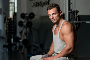 Young Muscular Caucasian Man Resting At The Bench