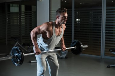 Man Doing Exercise For Back With Barbell