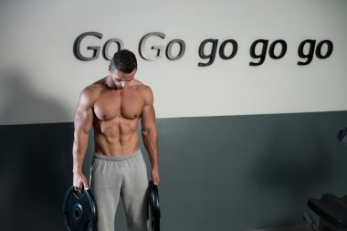 Strong Bodybuilder Training His Six Pack