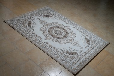 White Persian Rug Isolated On Tiles