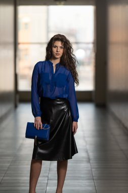Fashion Model Wearing Black Leather Skirt