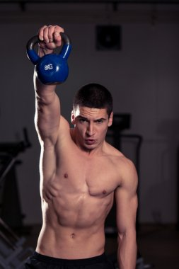 Muscular Men Exercise with Kettle Bell