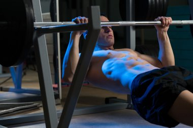 Men Exercising Back On Horizontal Barbell Pull Up