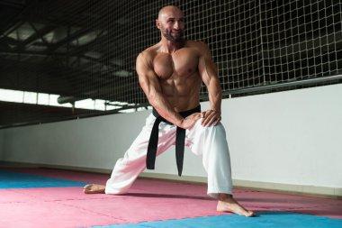 Flexible Man Stretching Before Training