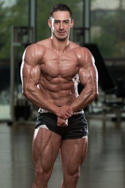 Handsome Body Builder Making Most Muscular Pose