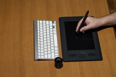 Hand Holding Drawing Tablet For Graphic Designer