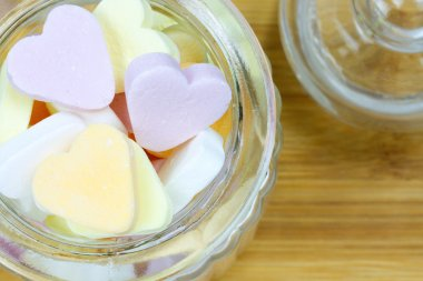 glass jar filled with heart candies