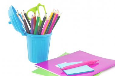 Colorful note books, pen and miniature dustbin with desk supplie