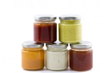 five jars filled with various sauces