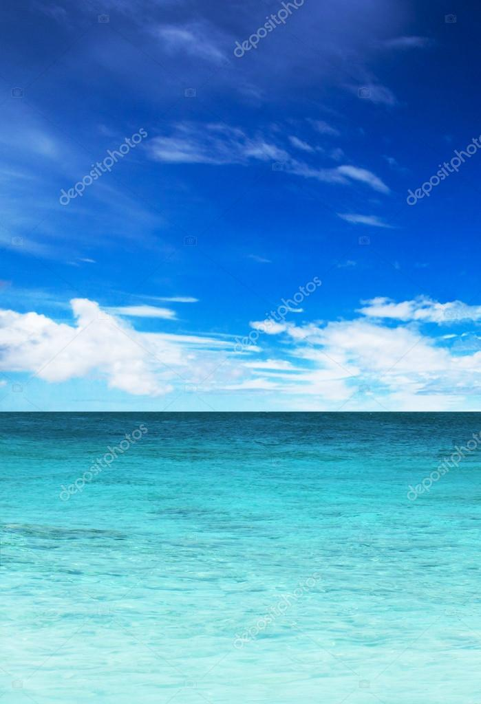 Turquoise water of the ocean and blue sky