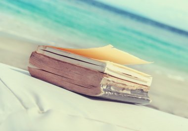 Old books on the beach